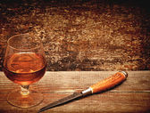 Knife and cognac — Stock Photo