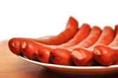 Closeup plate of sausages — Stock Photo
