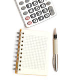 Pen, calculator and notepad — Stock Photo