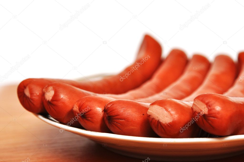 Closeup plate of sausages on the table — Stock Photo #4873316