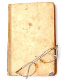 Old book with eyeglass — Stock Photo