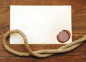 Old paper with a wax seal — Stock Photo