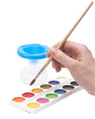 Hand with paintbrush — Stock Photo