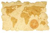 Världskarta med kompass på gamla papper — Stockfoto