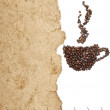 Coffee beans on old parchment paper — Stock Photo