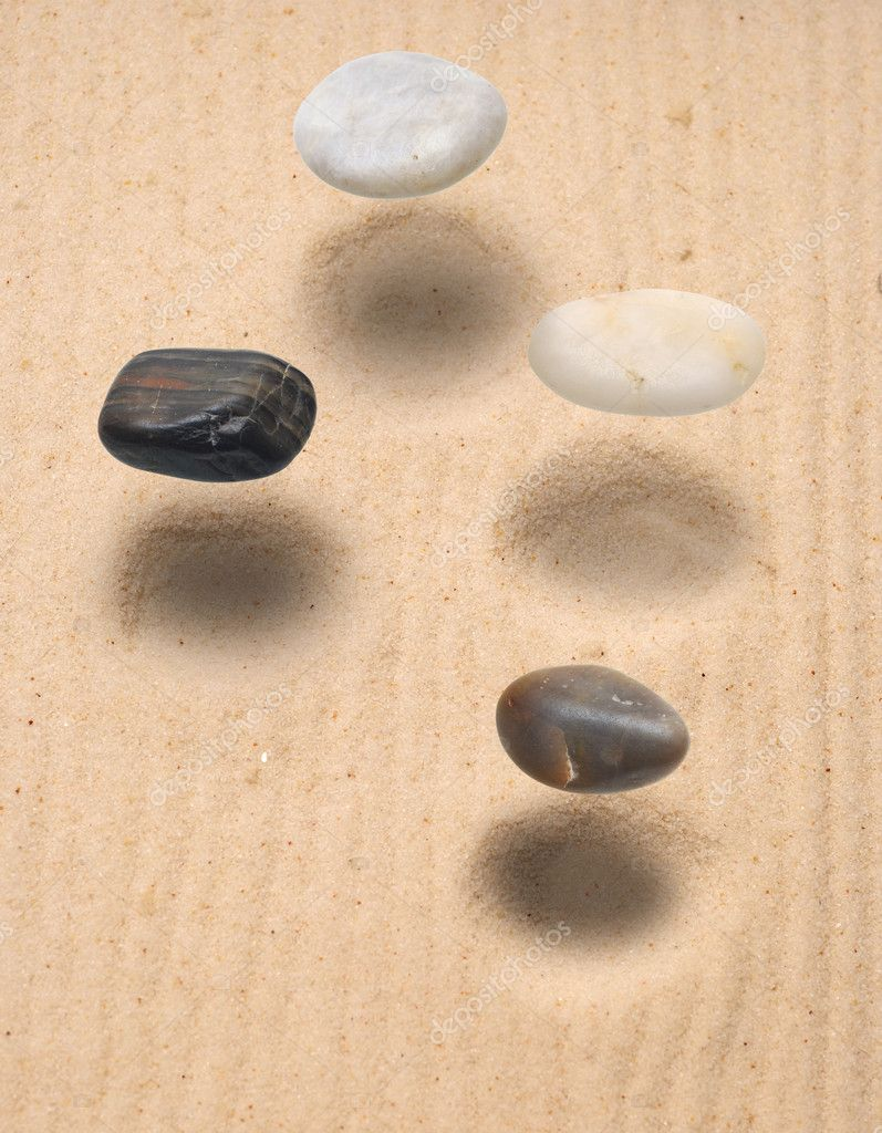 Levitation stones over sand — Stock Photo #5323351