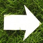 Cardboard navigation arrow — Stock Photo #5363108