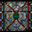 Colorful glass window in a church - Stock Photo