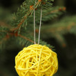 Decorative yellow ball on Christmas tree — Stock Photo