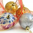 Stock Photo: Isolated colorful Christmas baubles and pink ribbon