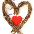 Red heart inside wooden heart — Stock Photo
