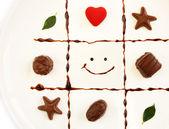 Valentine dish of chocolates — Stock Photo