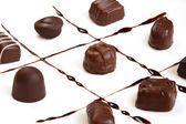 Chocolates on squares — Stock Photo