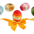 Orange ribbon and colorful eggs — Stock Photo
