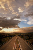 Cloudy sunset over highway — Stock Photo
