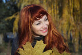 Beautiful girl with bright hair. Autumn. — Stock Photo