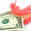Dentures and dollar — Stock Photo