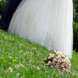Stock Photo: Bridal bouquet lies on grass