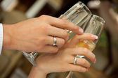 Bride and groom holding glasses — Stock Photo