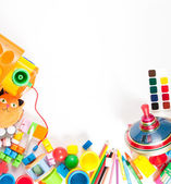 Children's toys scattered on a white sheet — Stock Photo