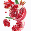 Falling pomegranate slices. — Stock Photo