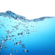 Air bubbles rise from the bottom of the ocean to the surface. Ai — Stock Photo