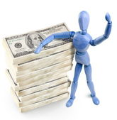 Wooden man standing over bundles of U.S. dollars — Stock Photo