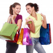 Two friends with shopping on a white background — Stock Photo #4225482