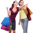 Two friends with shopping on a white background — Stock Photo