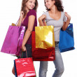 Stock Photo: Two young women with shoppping bags.