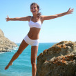 Beautiful brunette is happy on the beach — Stock Photo #4225636