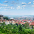 Beautiful panorama of red roofs of Prague's Old Town. - Stock Photo