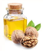 Walnut oil and nuts on white background. — Stock Photo