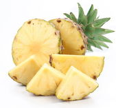 Cut ripe pineapple with rich green rosette. Isolated on a white. — Stock Photo