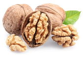 Walnuts with leaf isolated on a white background. — Stock Photo