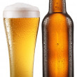 Bottle of beer with drops on white background. The file contains — Stock Photo