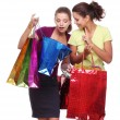 Two friends with shopping. One girl wonders purchases second gir — Stock Photo #4296987