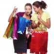 Two friends with shopping. One girl wonders purchases second gir - Stock Photo