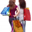 Two friends from the back with shopping on a white background — Stock Photo #4296994