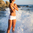 Happy beautiful girl in the sea waves - 
