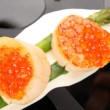 Grilled sea scallops with asparagus in a black plate - Stock Photo