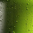 图库照片: Texture water drops on the bottle of beer.
