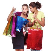 Two friends with shopping. One girl wonders purchases second gir — Stock Photo