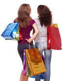 Two friends from the back with shopping on a white background — Stock Photo