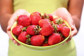 Crockery with cherries in woman hands. — Stock Photo