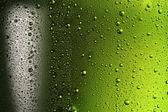 Texture water drops on the bottle of beer. — Stock Photo