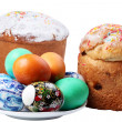 Royalty-Free Stock Photo: Multi-colored eggs on a plate and cakes. Easter holiday. Isolate