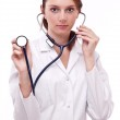 Doctor completing on medical card. Isolated on a white. — Stock Photo #4517915