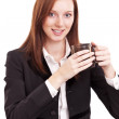 Young business woman holding a cup of coffee. Isolated on a whit — Stock Photo