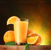 Oranges and glass of juice. — Stock Photo